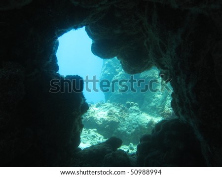 Exit of an underwater cavern. Looks out into open water.