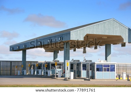 Exit of the multi lane toll booths of the Confederation Bridge, Prince Edward Island, Canada. - stock photo