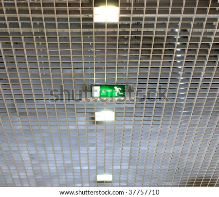 exit sign on a ceiling in supermarket - stock photo