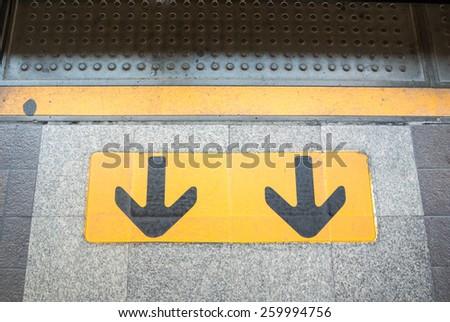 Exit sign on platform - stock photo