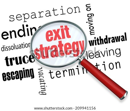 Exit Strategy words under a magnifying glass with terms separation, ending, dissolution, truce, escape, moving on, withdrawal, leaving and termination - stock photo
