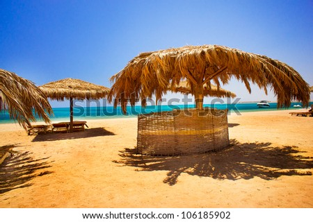 Exotic beach and gulf against blue sky - stock photo