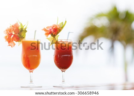 Exotic cocktails in a tropical setting - stock photo
