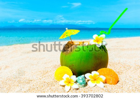 Exotic cocktain on the sandy beach. Vacation concept - stock photo