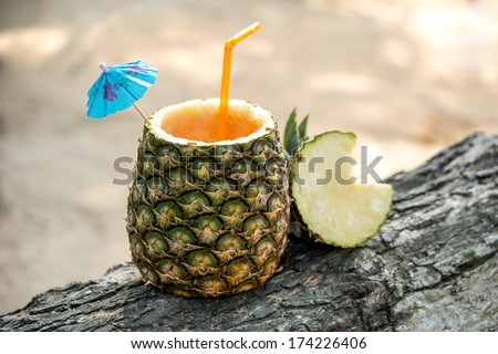 Exotic drink in a pineapple - stock photo