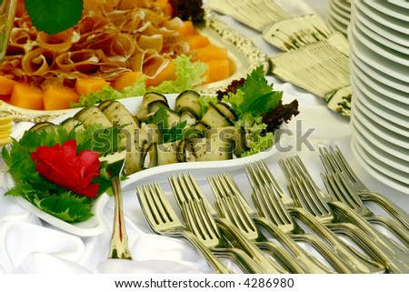 Exotic food with forks and plates waiting to start a party