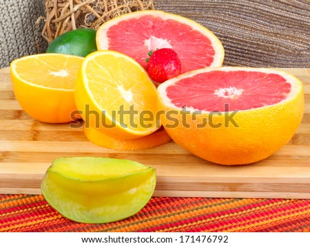 Exotic Fruit on wooden board. grapefruit,carambol a and orange slices