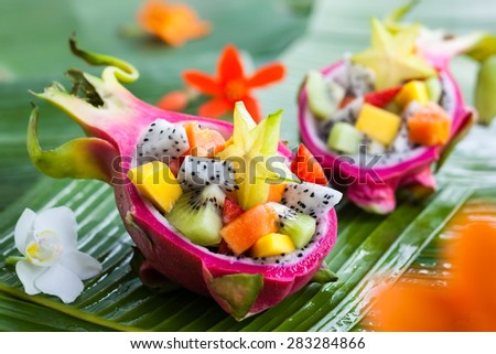 Exotic fruit salad served in half a dragon fruit - stock photo