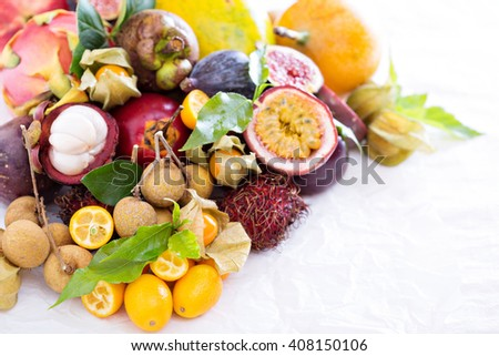 Exotic fruits on white  with kumquats and figs - stock photo
