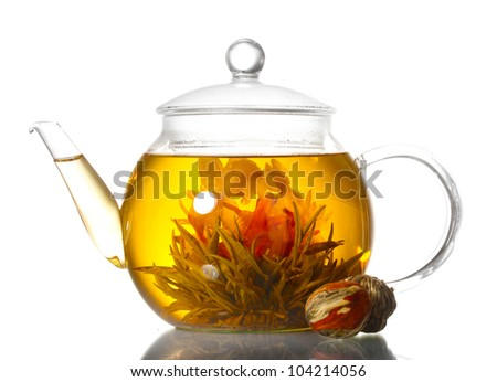 exotic green tea with flowers in glass teapot isolated on white - stock photo