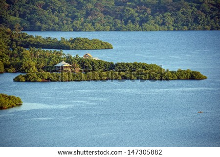 Exotic landscape with dusk light over tropical island and house, Bocas del Toro, Panama - stock photo