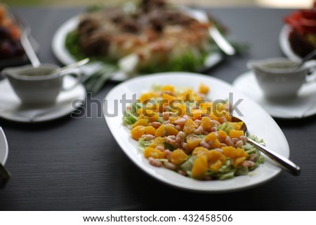 Exotic salad with prawns and fruits served in a restaurant