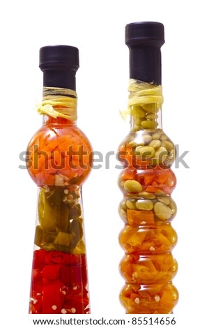 Exotic Spices in Exotic Clear Glass Bottles. Clipped Photo - Solid White Background