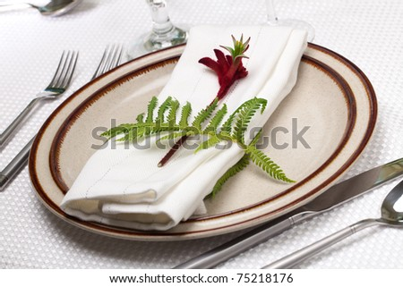 Exotic theme table setting. Arrangements with fresh fern and kangaroo paws flower - stock photo