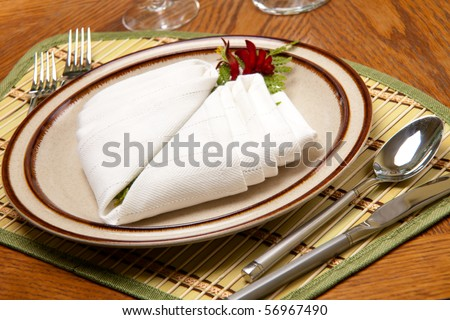 Exotic theme table setting. Arrangments with fresh fern and kangaroo paws flower - stock photo