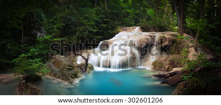 Exotic tropical waterfall in green jungle forest with plants and trees of rainforest. National park beautiful nature background - stock photo