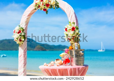 exotic Wedding ceremony on the shore of the ocean sea arch on the beach - stock photo