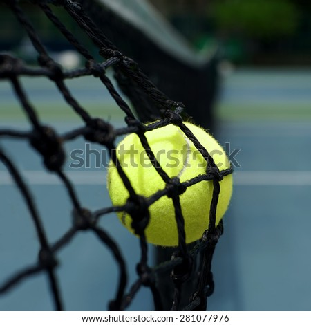 exotic yellow color tennis ball in the net