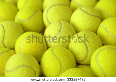 exotic yellow tennis ball as sport background - stock photo