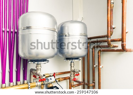 expansion tanks in boiler-room - stock photo