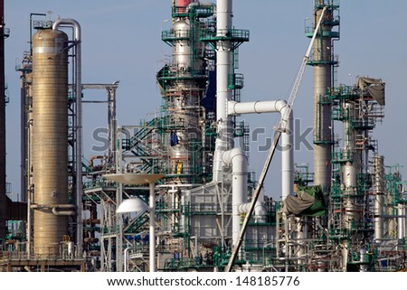 Expansion works at a refinery and powerplant seeing new equipment - stock photo