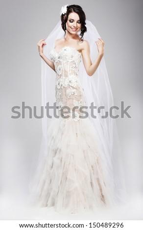 Expectation. Beautiful Jubilant Bride in White Wedding Dress - stock photo
