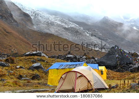 Expedition tents in the Annapurna Base Camp, Himalaya mountains, Nepal in a cloudy day - stock photo