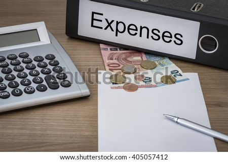 Expenses written on a binder on a desk with euro money calculator blank sheet and pen