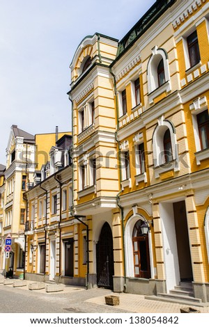 Expensive apartment in yellow building - stock photo