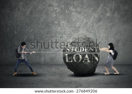 Expensive education costs concept with students pulling and pushing heavy stone - stock photo