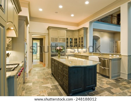 Expensive kitchen interior with granite counters and slate floor