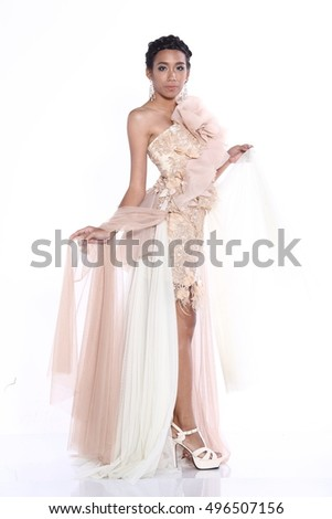 expensive Tan Skin fashion woman in a beautiful gown, white background, swing and fluttering