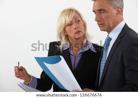 Experienced businessman people reviewing document - stock photo