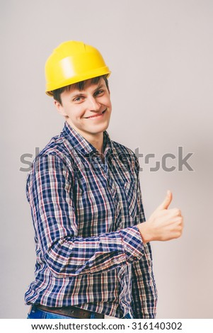 experienced carpenter giving thumb up  - stock photo
