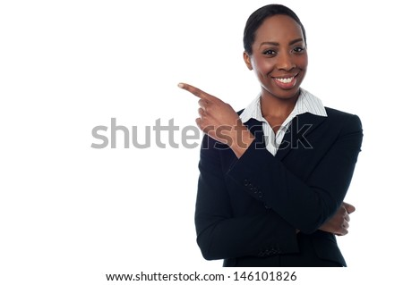 Experienced female executive pointing away
