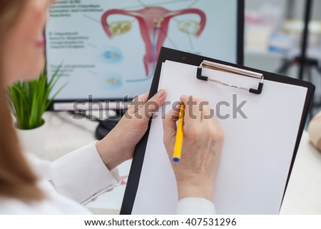 Experienced general practitioner is working with documents - stock photo