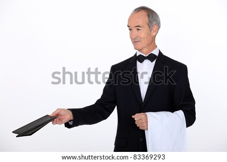 Experiences waiter holding menu - stock photo