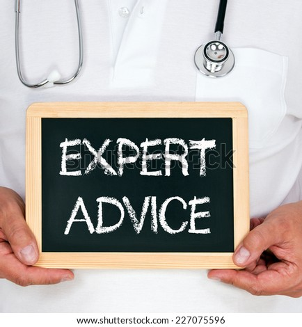 Expert Advice - Physician with chalkboard - stock photo