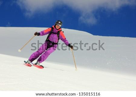 Expert female skier in the Utah mountains, USA. - stock photo