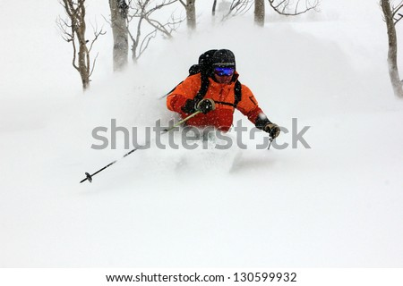 Expert skier in fresh powder snow during a blizzard, Utah, USA. - stock photo