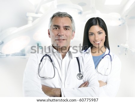 expertise gray hair doctor beautiful nurse in hospital white corridor [Photo Illustration] - stock photo
