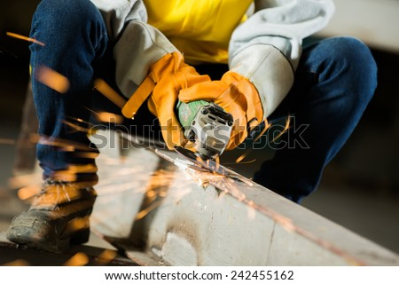 Experts are grinding steel The industries of the action. To clean steel - stock photo