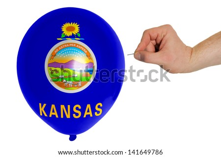 exploding balloon colored in flag of us state of kansas - stock photo
