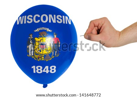 exploding balloon colored in flag of us state of wisconsin - stock photo