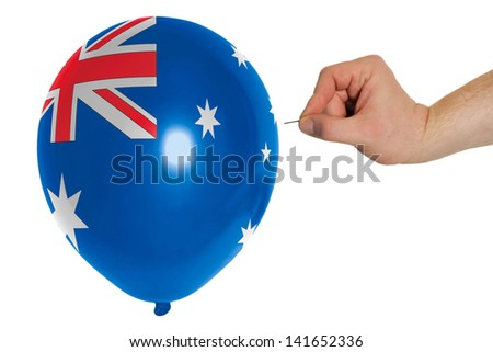 exploding balloon colored in national flag of australia - stock photo