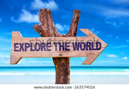 Explore the World sign with a beach on background - stock photo