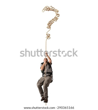 Explorer clinging to a rope of interrogative - stock photo