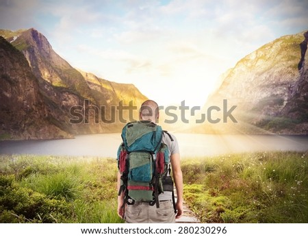 Explorer find a lake in beautiful landscape - stock photo