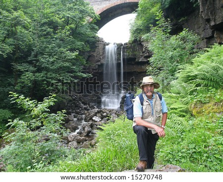 Explorer in the Garden of Eden, with spectacular fiftey feet high  Ashgill  Force in background located near to the small isolated market town of Alston in Cumbria's Eden district - stock photo