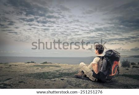 Explorer observing the horizon  - stock photo
